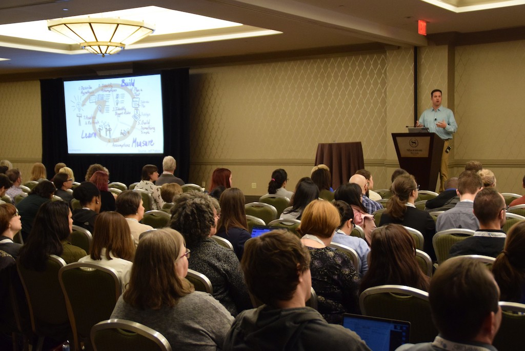 Dan speaking in front of a large audience at UXPA Boston 2019